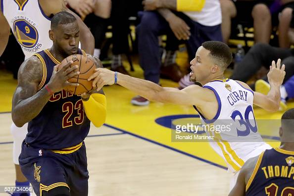 LeBron James of the Cleveland Cavaliers with the ball against Stephen Curry of the Golden State Warriors in the first half in Game 1 of the 2016 NBA...