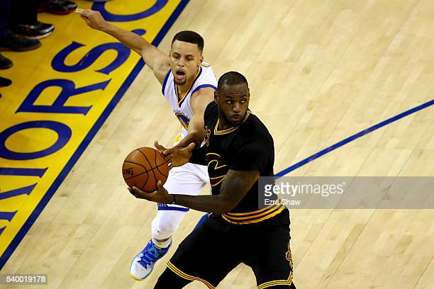 LeBron James of the Cleveland Cavaliers with the ball as Stephen Curry of the Golden State Warriors goes for the steal in Game 5 of the 2016 NBA...