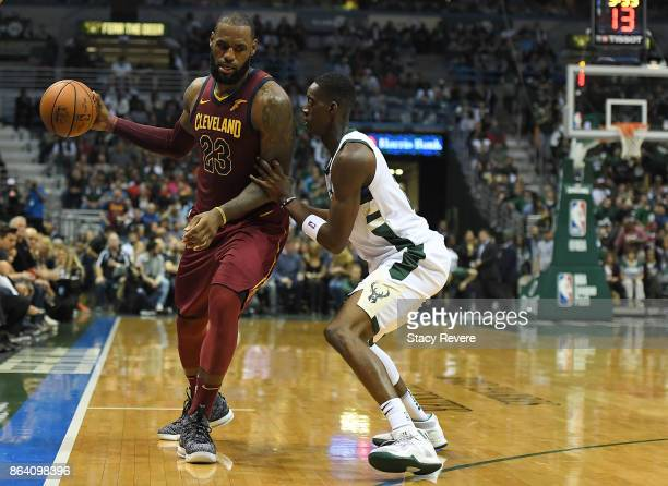 LeBron James of the Cleveland Cavaliers works against Tony Snell of the Milwaukee Bucks during the second half of a game at the Bradley Center on...