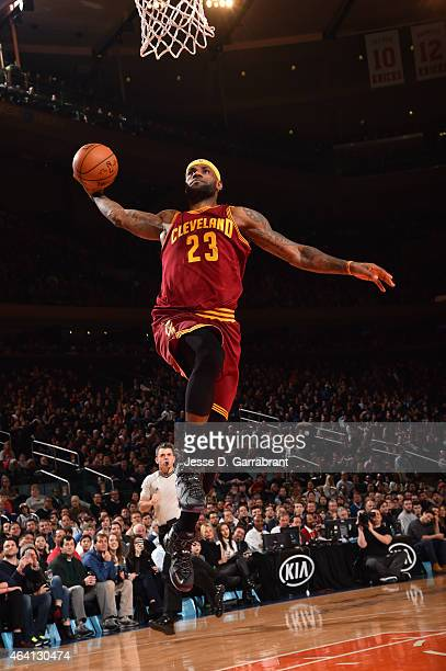 LeBron James of the Cleveland Cavilers goes up for the dunk against the New York Knicks on February 22 2015 at Madison Square Garden in New York City...