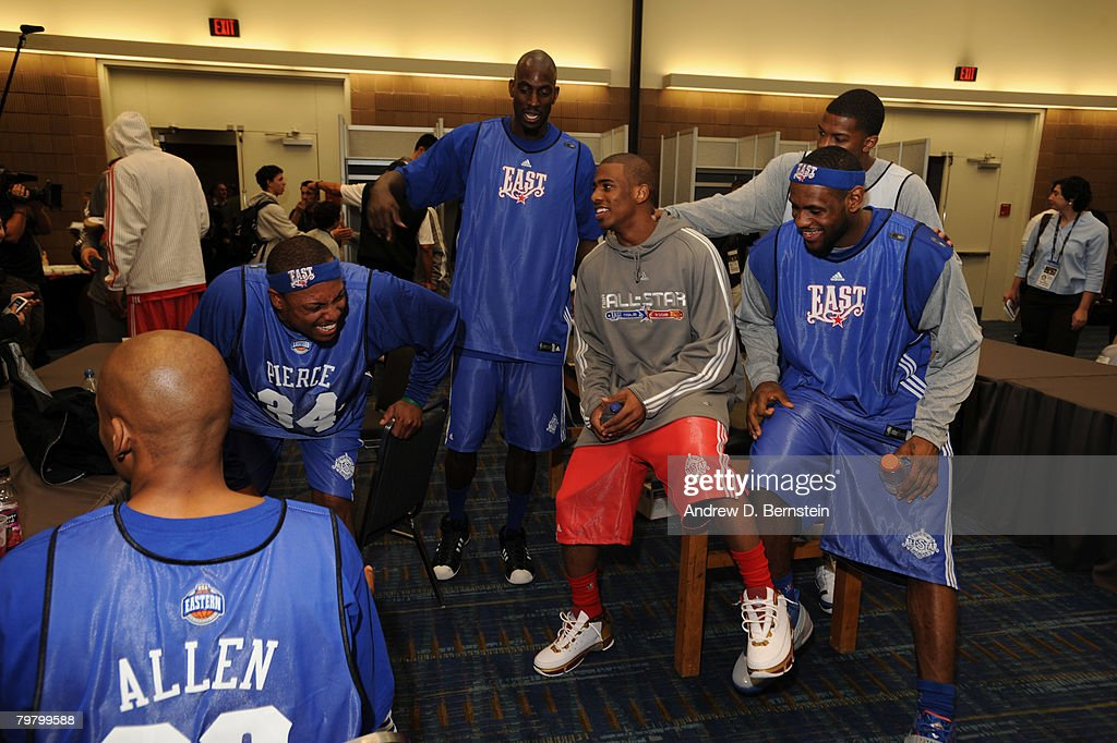 LeBron James of the East AllStars and Chris Paul of the West AllStars laugh prior to the East AllStars Practice on center court at NBA Jam Session...
