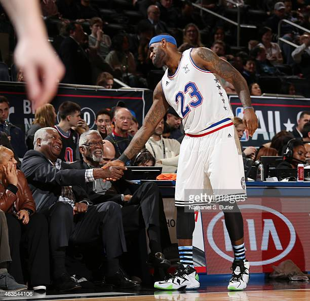 LeBron James of the Eastern Conference AllStar Team shakes hands with NBA Legend Oscar Robertson during the 64th NBA AllStar Game presented by Kia as...