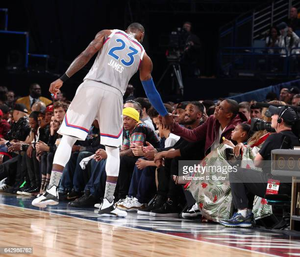 LeBron James of the Eastern Conference AllStars greets JayZ during the NBA AllStar Game as part of the 2017 NBA All Star Weekend on February 19 2017...