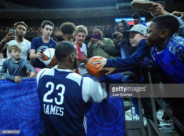 LeBron James of the Eastern Conference AllStars signs autographs during the NBA DLeague All Star Game as part of 2017 AllStar Weekend at the...