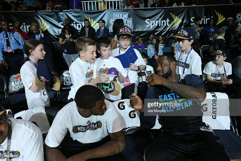 LeBron James #6 of the Eastern Conference All-Stars signs his autograph for young fans during the NBA All-Star Practices at Sprint Arena as part of 2014 NBA All-Star Weekend at the Ernest N. Morial Convention Center on February 15, 2014 in New Orleans, Louisiana.