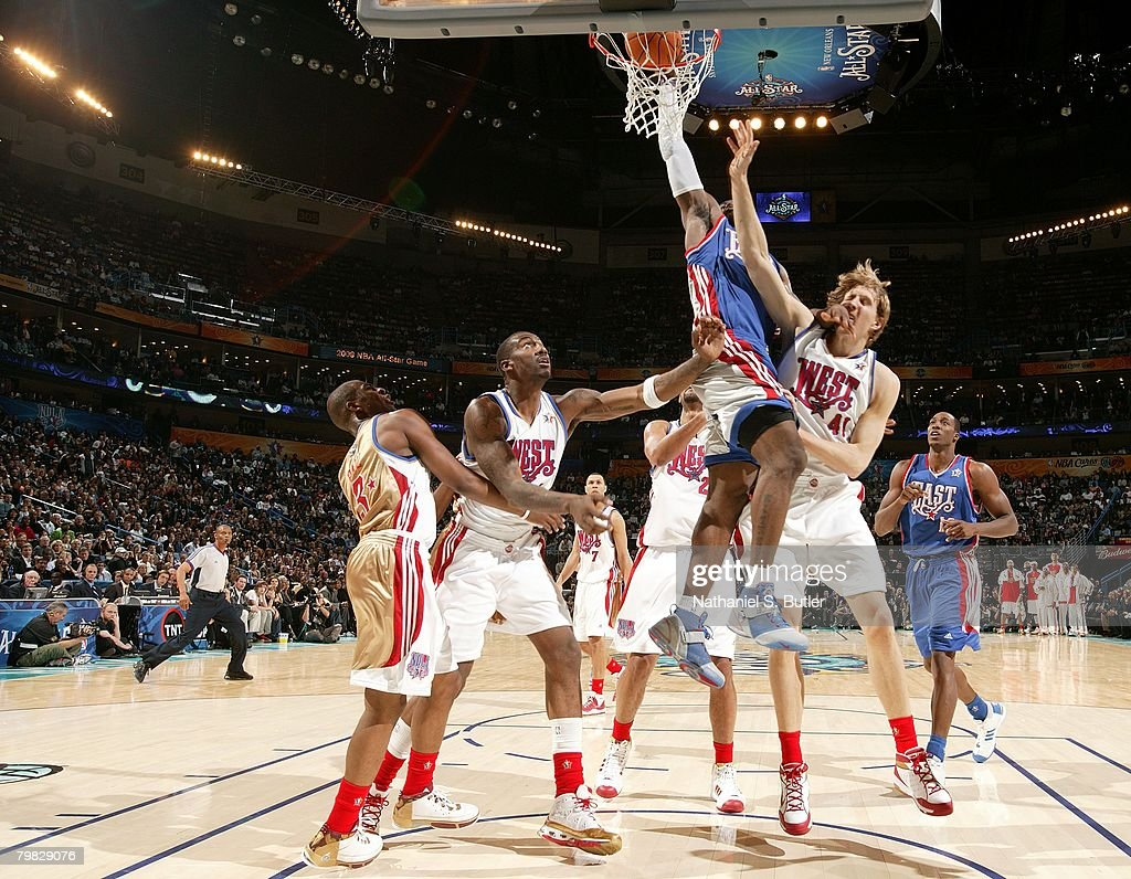 <a gi-track='captionPersonalityLinkClicked' href=/galleries/search?phrase=LeBron+James&family=editorial&specificpeople=201474 ng-click='$event.stopPropagation()'>LeBron James</a> #23 of the Eastern Conference dunks over Dirk Nowitzki #41 and Amare Stoudemire #1 of the Western Conference during the fourth quarter of the 2008 NBA All-Star Game part of 2008 NBA All-Star Weekend at the New Orleans Arena on February 17, 2008 in New Orleans, Louisiana.