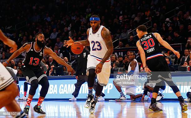 LeBron James of the Eastern Conference in action against James Harden and Stephen Curry of the Western Conference during the 2015 NBA AllStar Game at...