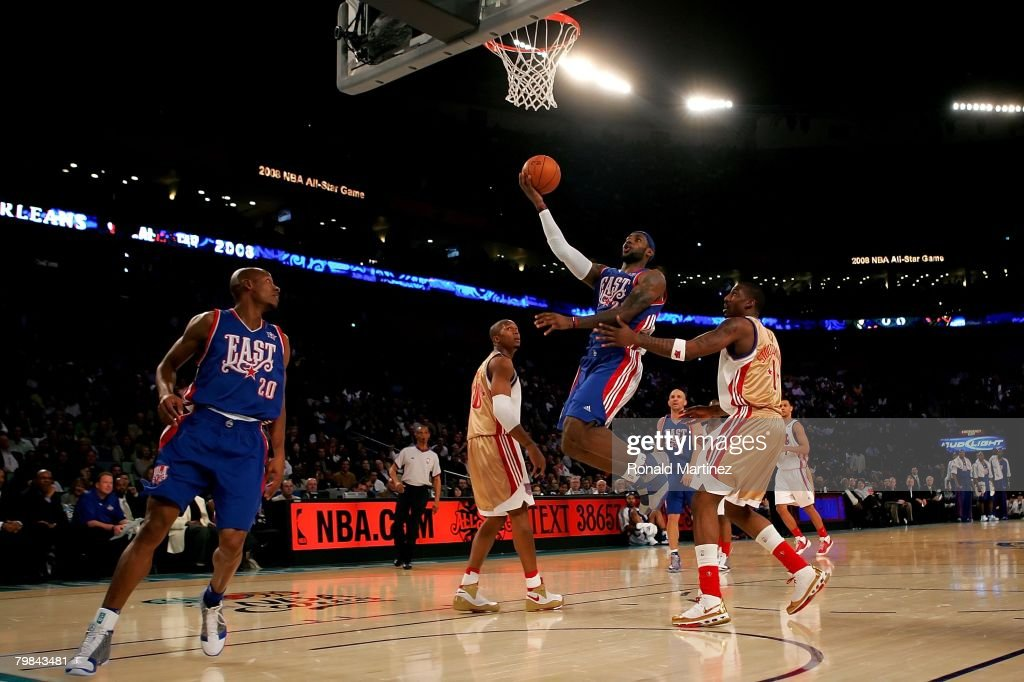 <a gi-track='captionPersonalityLinkClicked' href=/galleries/search?phrase=LeBron+James&family=editorial&specificpeople=201474 ng-click='$event.stopPropagation()'>LeBron James</a> #23 of the Eastern Conference lays the ball up over David West #30 and Amare Stoudemire #1 of the Western Conference during the 57th NBA All-Star Game, part of 2008 NBA All-Star Weekend at the New Orleans Arena on February 17, 2008 in New Orleans, Louisiana. The East won 134-128.