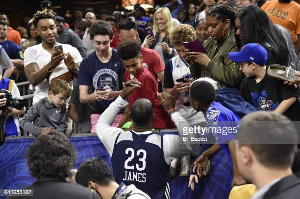 LeBron James of the Eastern Conference signs his autograph for fans after the 2017 NBA AllStar Practice as a part of 2017 AllStar Weekend at the...