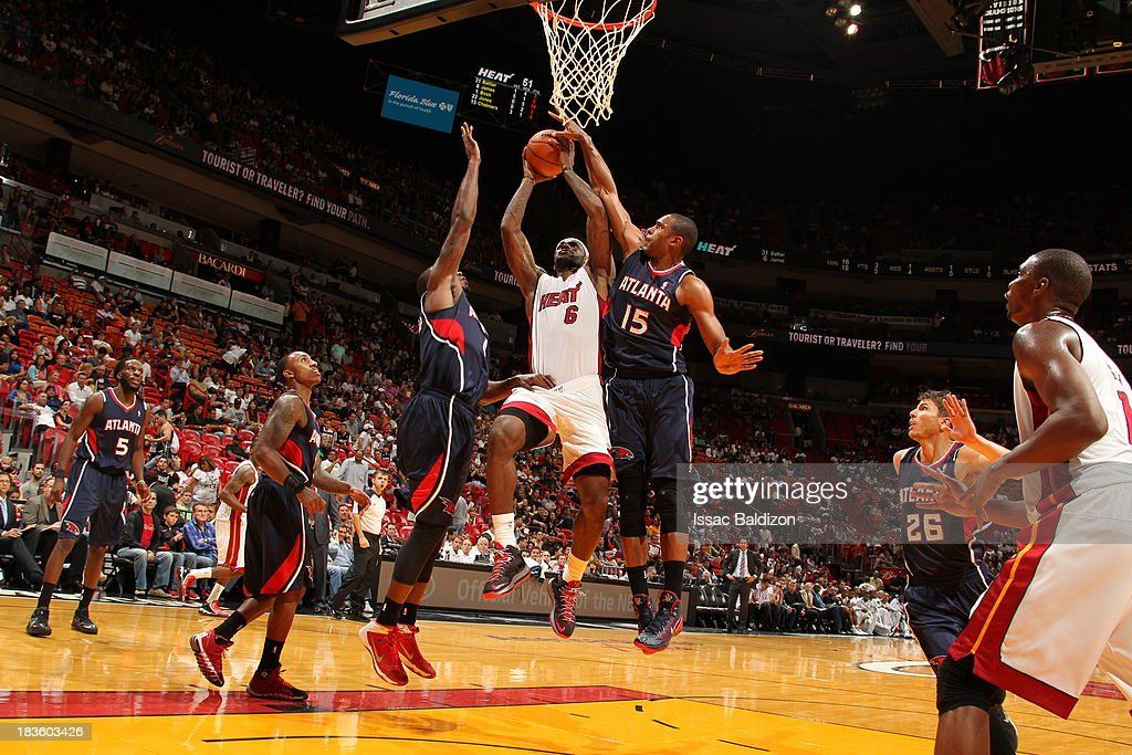 <a gi-track='captionPersonalityLinkClicked' href=/galleries/search?phrase=LeBron+James&family=editorial&specificpeople=201474 ng-click='$event.stopPropagation()'>LeBron James</a> #6 of the Miami Heat against <a gi-track='captionPersonalityLinkClicked' href=/galleries/search?phrase=Al+Horford&family=editorial&specificpeople=699030 ng-click='$event.stopPropagation()'>Al Horford</a> #15 of the Atlanta Hawks during a game on October 7, 2013 at American Airlines Arena in Miami, Florida.
