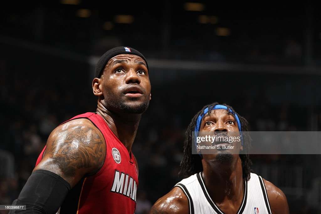LeBron James #6 of the Miami Heat and Gerald Wallace #45 of the Brooklyn Nets look on during a game played on January 30, 2013 at the Barclays Center in the Brooklyn borough of New York City.