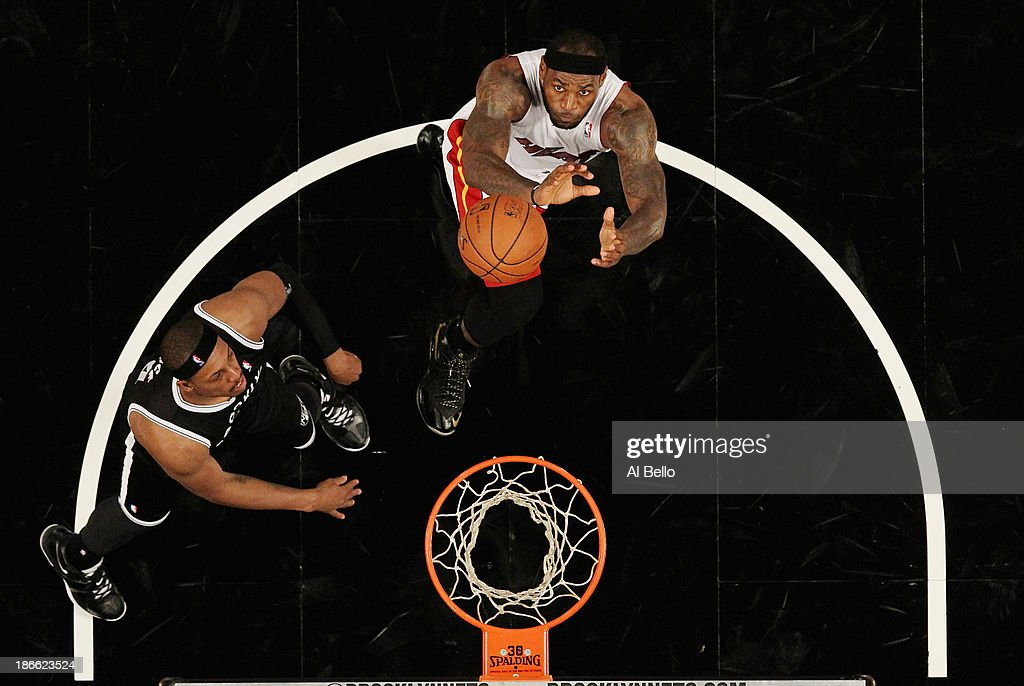 <a gi-track='captionPersonalityLinkClicked' href=/galleries/search?phrase=LeBron+James&family=editorial&specificpeople=201474 ng-click='$event.stopPropagation()'>LeBron James</a> #6 of the Miami Heat and <a gi-track='captionPersonalityLinkClicked' href=/galleries/search?phrase=Paul+Pierce&family=editorial&specificpeople=201562 ng-click='$event.stopPropagation()'>Paul Pierce</a> #34 of the Brooklyn Nets battle for the ball during their game at the Barclays Center on November 1, 2013 in the Brooklyn borough of New York City.