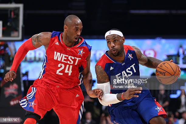 LeBron James of the Miami Heat and the Eastern Conference drives on Kobe Bryant of the Los Angeles Lakers and the Western Conference during the 2013...