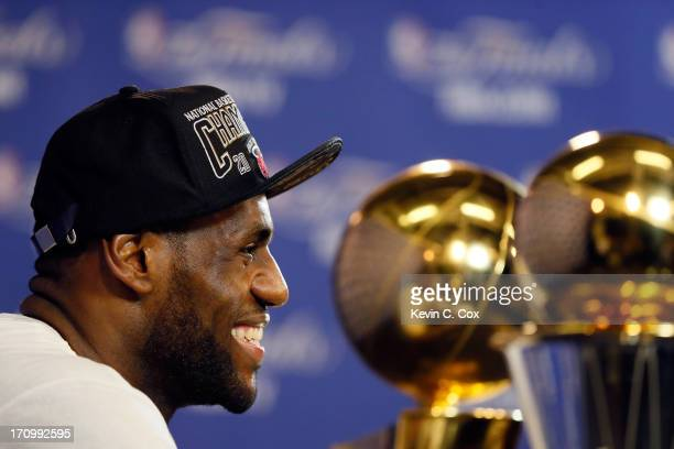 LeBron James of the Miami Heat answers questions as he celebrates after defeating the San Antonio Spurs 9588 to win Game Seven of the 2013 NBA Finals...