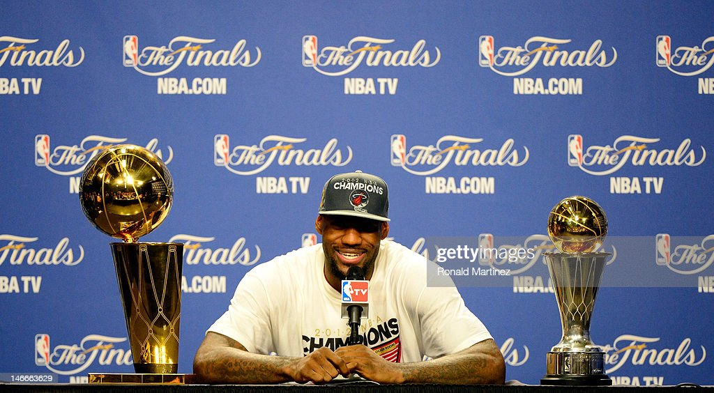 <a gi-track='captionPersonalityLinkClicked' href=/galleries/search?phrase=LeBron+James&family=editorial&specificpeople=201474 ng-click='$event.stopPropagation()'>LeBron James</a> #6 of the Miami Heat answers questions from the media next to the Larry O'Brien Finals Championship trophy and James' Bill Russell Finals MVP trophy during his post game press conference after they won 121-106 against the Oklahoma City Thunder in Game Five of the 2012 NBA Finals on June 21, 2012 at American Airlines Arena in Miami, Florida.