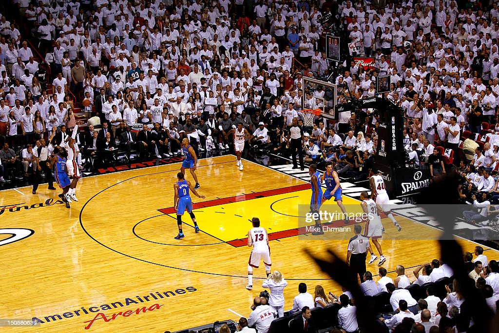 LeBron James #6 of the Miami Heat attempts a 3-point shot against James Harden #13 of the Oklahoma City Thunder in Game Five of the 2012 NBA Finals on June 21, 2012 at American Airlines Arena in Miami, Florida.