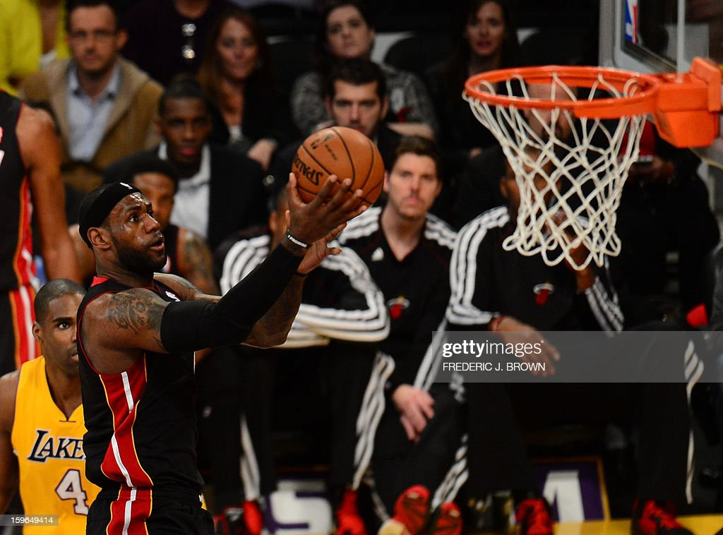 LeBron James of the Miami Heat attempts a shot against Los Angeles Lakers during their NBA game on January 17, 2013 in Los Angeles, California. AFP PHOTO / Frederic J. BROWN