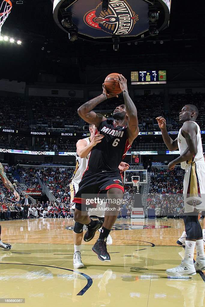 <a gi-track='captionPersonalityLinkClicked' href=/galleries/search?phrase=LeBron+James&family=editorial&specificpeople=201474 ng-click='$event.stopPropagation()'>LeBron James</a> #6 of the Miami Heat attempts a shot against the New Orleans Pelicans during an NBA preseason game on October 23,2013 at the New Orleans Arena in New Orleans, Louisiana.