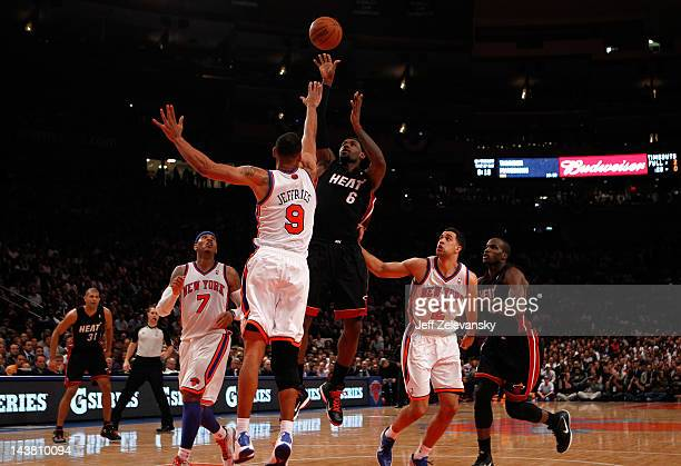 LeBron James of the Miami Heat attempts a shot in the second half against Jared Jeffries of the New York Knicks in Game Three of the Eastern...