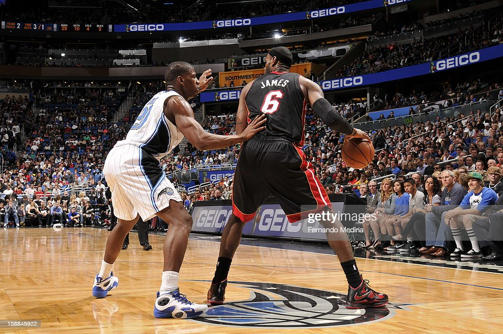 LeBron James #6 of the Miami Heat backs up to the basket against the Orlando Magic during the game on December 31, 2012 at Amway Center in Orlando, Florida.