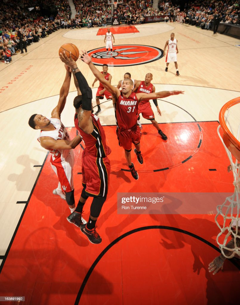 <a gi-track='captionPersonalityLinkClicked' href=/galleries/search?phrase=LeBron+James&family=editorial&specificpeople=201474 ng-click='$event.stopPropagation()'>LeBron James</a> #6 of the Miami Heat battles for the ball control with <a gi-track='captionPersonalityLinkClicked' href=/galleries/search?phrase=Rudy+Gay&family=editorial&specificpeople=236066 ng-click='$event.stopPropagation()'>Rudy Gay</a> #22 of the Toronto Raptors during the game between the Toronto Raptors and the Miami Heat on March 17, 2013 at the Air Canada Centre in Toronto, Ontario, Canada.