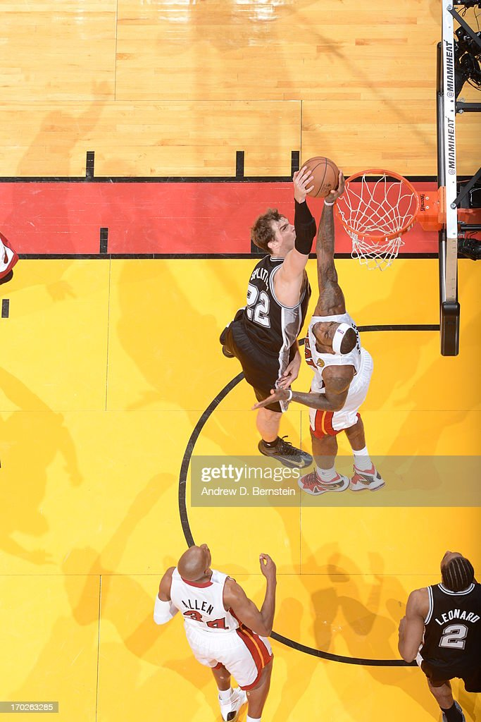 <a gi-track='captionPersonalityLinkClicked' href=/galleries/search?phrase=LeBron+James&family=editorial&specificpeople=201474 ng-click='$event.stopPropagation()'>LeBron James</a> #6 of the Miami Heat blocks a dunk against <a gi-track='captionPersonalityLinkClicked' href=/galleries/search?phrase=Tiago+Splitter&family=editorial&specificpeople=208218 ng-click='$event.stopPropagation()'>Tiago Splitter</a> #22 of the San Antonio Spurs during Game Two of the 2013 NBA Finals on June 9, 2013 at American Airlines Arena in Miami, Florida.