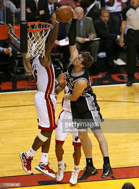 LeBron James of the Miami Heat blocks the shot of Tiago Splitter of the San Antonio Spurs in the fourth quarter during Game Two of the 2013 NBA...