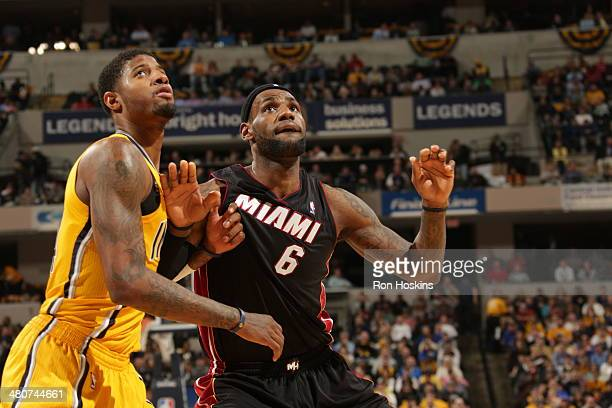 LeBron James of the Miami Heat boxes out Paul George of the Indiana Pacers during the game at Bankers Life Fieldhouse on March 26 2014 in...