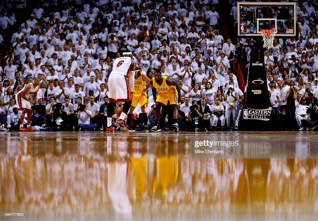 LeBron James of the Miami Heat brings the ball up the floor as Lance Stephenson of the Indiana Pacers defends during Game Six of the Eastern...