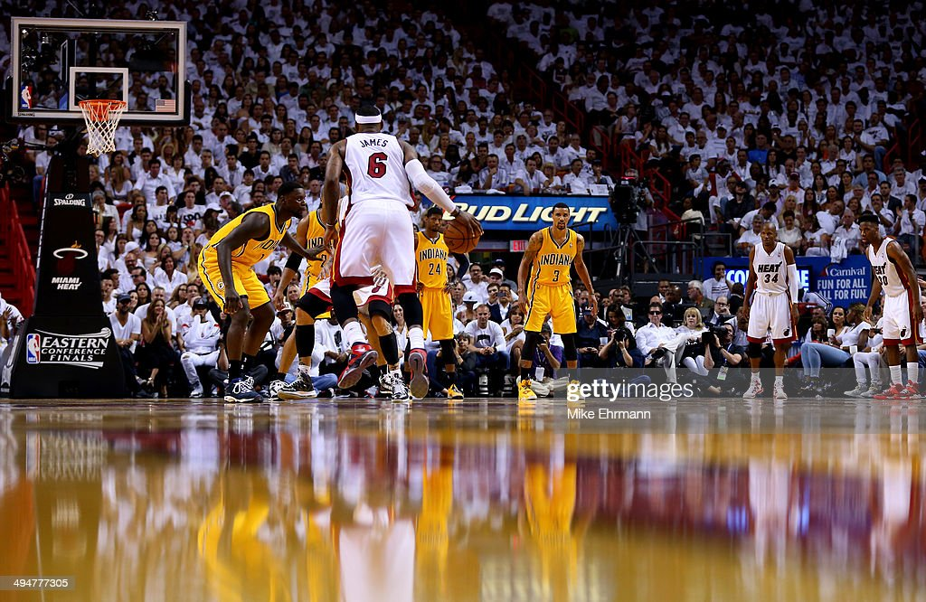 <a gi-track='captionPersonalityLinkClicked' href=/galleries/search?phrase=LeBron+James&family=editorial&specificpeople=201474 ng-click='$event.stopPropagation()'>LeBron James</a> #6 of the Miami Heat brings the ball up the floor as <a gi-track='captionPersonalityLinkClicked' href=/galleries/search?phrase=Lance+Stephenson&family=editorial&specificpeople=5298304 ng-click='$event.stopPropagation()'>Lance Stephenson</a> #1 of the Indiana Pacers defends during Game Six of the Eastern Conference Finals of the 2014 NBA Playoffs at American Airlines Arena on May 30, 2014 in Miami, Florida.