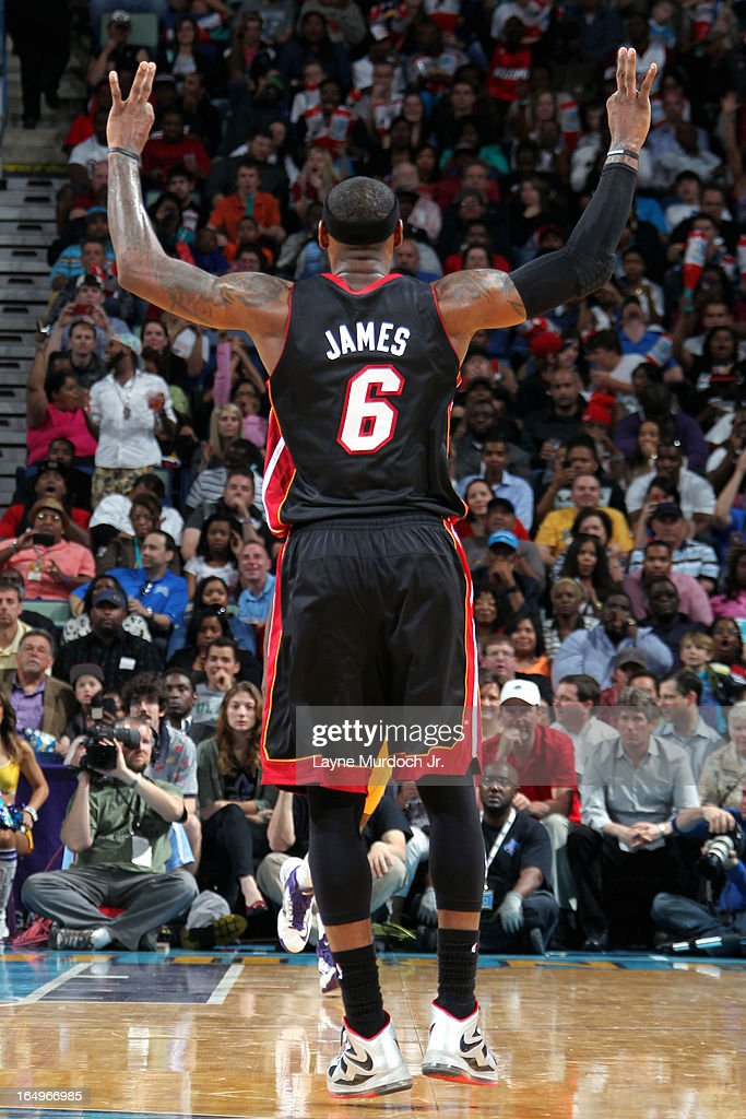 <a gi-track='captionPersonalityLinkClicked' href=/galleries/search?phrase=LeBron+James&family=editorial&specificpeople=201474 ng-click='$event.stopPropagation()'>LeBron James</a> #6 of the Miami Heat celebrates during the game against the New Orleans Hornets on March 29, 2013 at the New Orleans Arena in New Orleans, Louisiana.