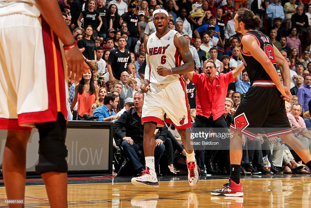 <a gi-track='captionPersonalityLinkClicked' href=/galleries/search?phrase=LeBron+James&family=editorial&specificpeople=201474 ng-click='$event.stopPropagation()'>LeBron James</a> #6 of the Miami Heat celebrates while playing the Chicago Bulls on January 4, 2013 at American Airlines Arena in Miami, Florida.