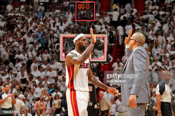 LeBron James of the Miami Heat celebrates with assistant coach David Fizdale while playing the Indiana Pacers in Game Two of the Eastern Conference...