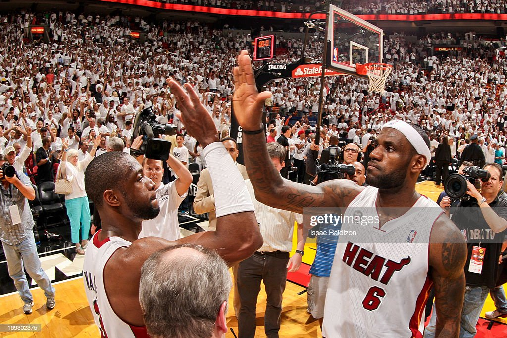LeBron James #6 of the Miami Heat celebrates with teammate Dwyane Wade #3 after James' game-winning layup in overtime against the Indiana Pacers in Game One of the Eastern Conference Finals during the 2013 NBA Playoffs on May 22, 2013 at American Airlines Arena in Miami, Florida.