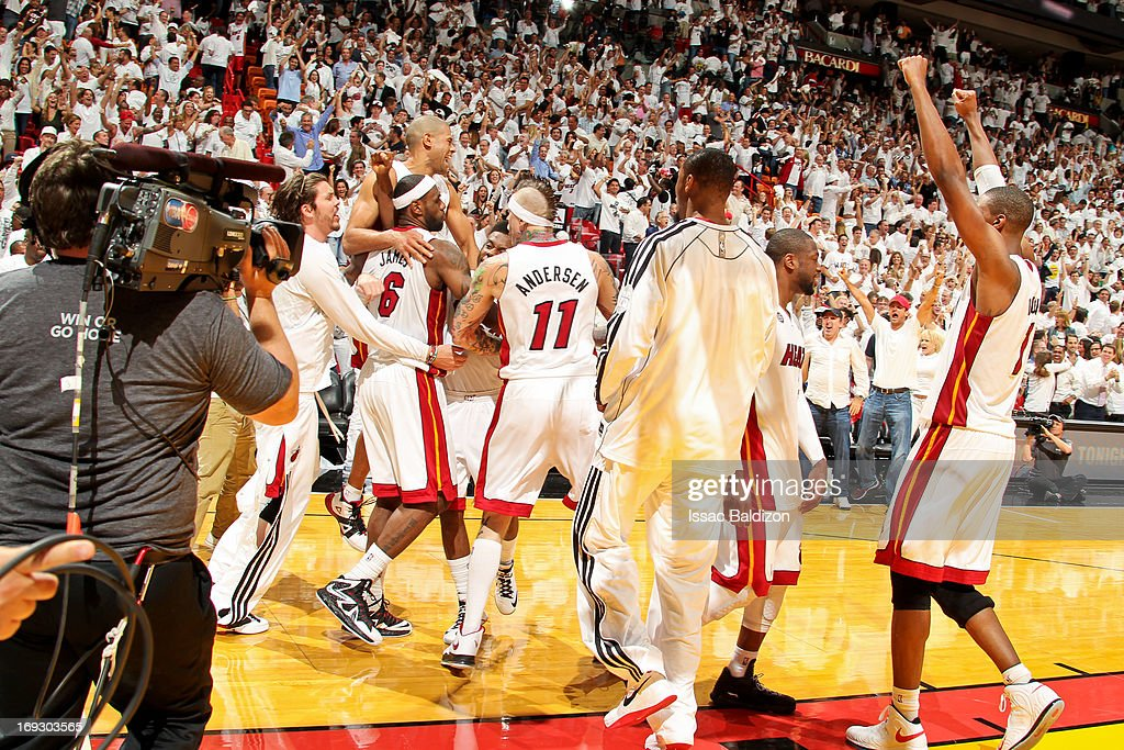 <a gi-track='captionPersonalityLinkClicked' href=/galleries/search?phrase=LeBron+James&family=editorial&specificpeople=201474 ng-click='$event.stopPropagation()'>LeBron James</a> #6 of the Miami Heat celebrates with teammates after his game-winning layup in overtime against the Indiana Pacers in Game One of the Eastern Conference Finals during the 2013 NBA Playoffs on May 22, 2013 at American Airlines Arena in Miami, Florida.