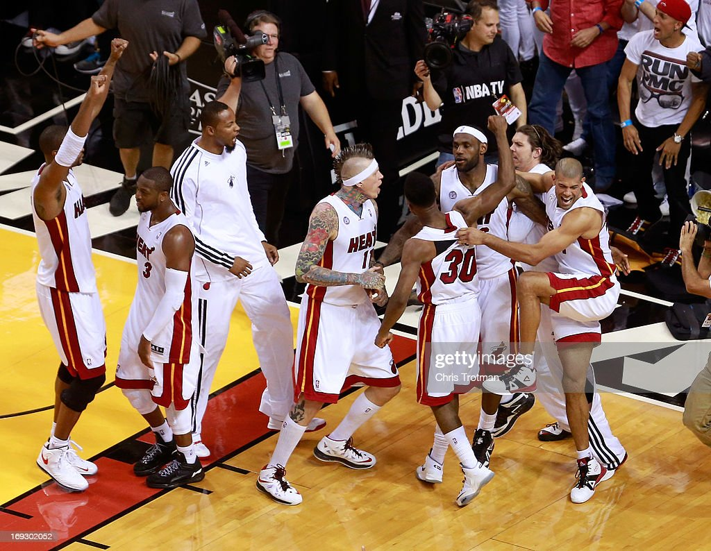 LeBron James of the Miami Heat celebrates with teammates after making the game winning basket in overtime against the Indiana Pacers during Game One...