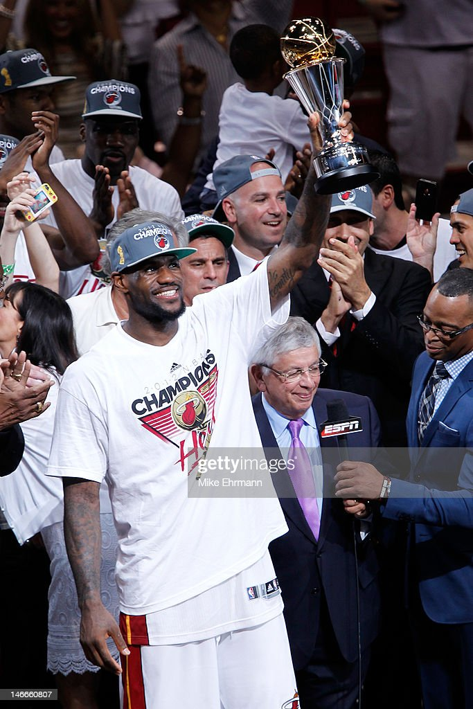 LeBron James #6 of the Miami Heat celebrates with the Bill Russell Finals MVP trophy after they won 121-106 against the Oklahoma City Thunder in Game Five of the 2012 NBA Finals on June 21, 2012 at American Airlines Arena in Miami, Florida.