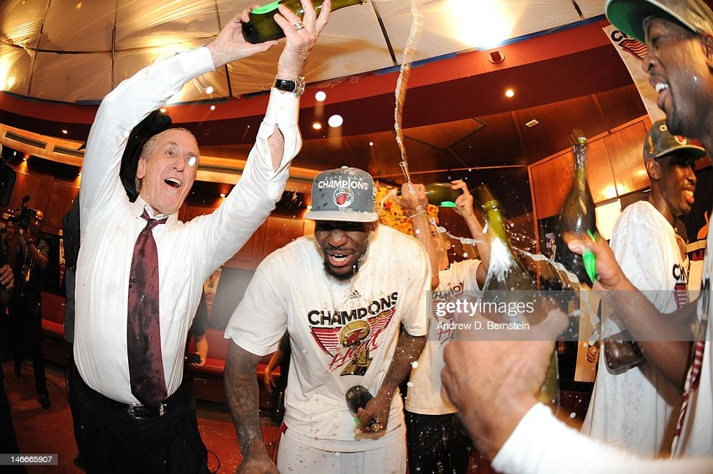LeBron James #6 of the Miami Heat celerates with Miami Heat team President Pat Riley in a locker room after winning Game Five of the 2012 NBA Finals between the Miami Heat and the Oklahoma City Thunder at American Airlines Arena on June 21, 2012 in Miami, Florida.