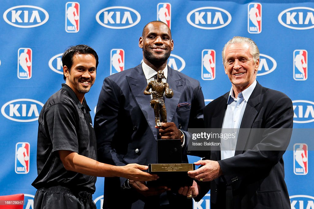 LeBron James #6 of the Miami Heat, center, holds the Maurice Podoloff Trophy while posing with head coach Erik Spoelstra, left, and team president Pat Riley after being named the 2012-2013 Kia NBA Most Valuable Player (MVP) of the Year on May 5, 2013 at American Airlines Arena in Miami, Florida.