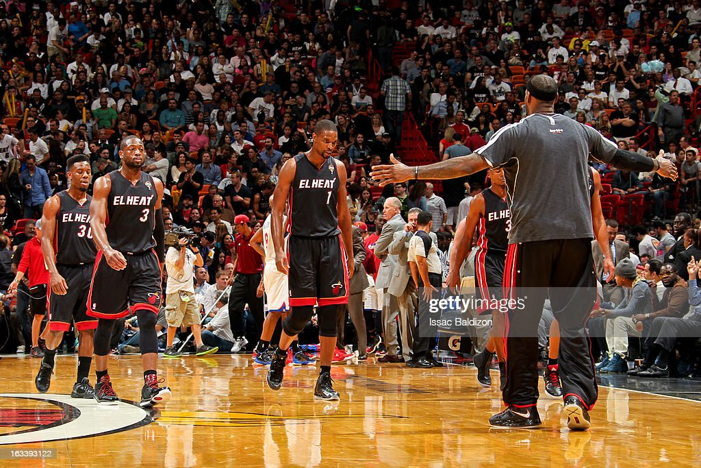 LeBron James #6 of the Miami Heat congratulates teammates walking to the bench for a timeout during a game against the Philadelphia 76ers on March 8, 2013 at American Airlines Arena in Miami, Florida.