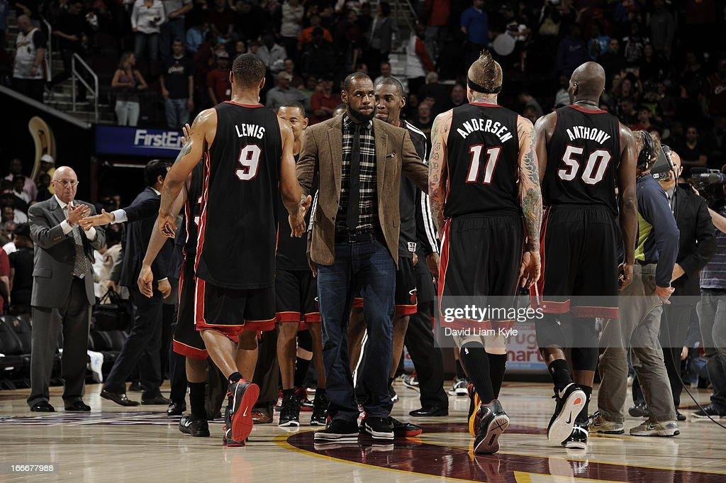 LeBron James #6 of the Miami Heat congratulates the team as they walk off the court following their victory over the Cleveland Cavaliers at The Quicken Loans Arena on April 15, 2013 in Cleveland, Ohio.