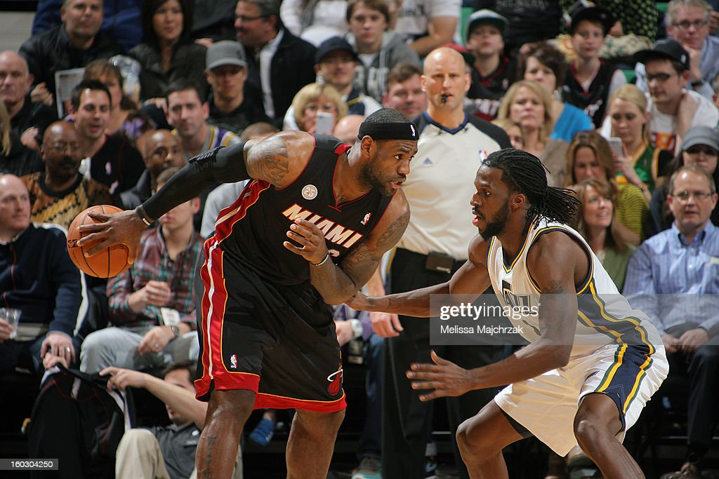 <a gi-track='captionPersonalityLinkClicked' href=/galleries/search?phrase=LeBron+James&family=editorial&specificpeople=201474 ng-click='$event.stopPropagation()'>LeBron James</a> #6 of the Miami Heat controls the ball against <a gi-track='captionPersonalityLinkClicked' href=/galleries/search?phrase=DeMarre+Carroll&family=editorial&specificpeople=784686 ng-click='$event.stopPropagation()'>DeMarre Carroll</a> #3 of the Utah Jazz at Energy Solutions Arena on January 14, 2013 in Salt Lake City, Utah.