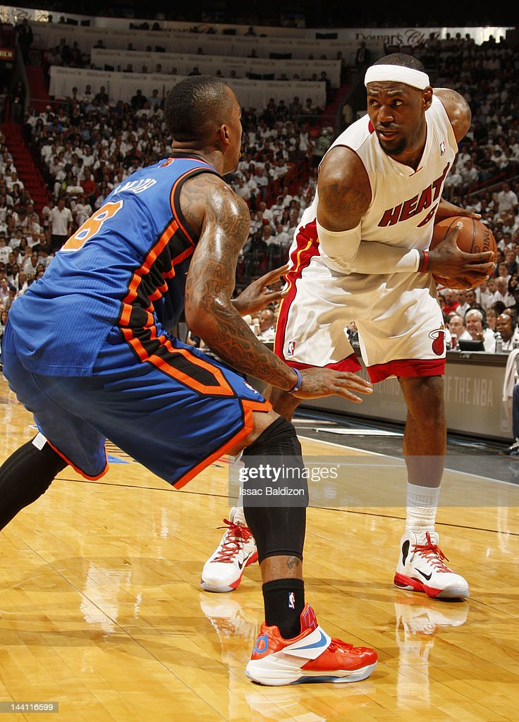 <a gi-track='captionPersonalityLinkClicked' href=/galleries/search?phrase=LeBron+James&family=editorial&specificpeople=201474 ng-click='$event.stopPropagation()'>LeBron James</a> #6 of the Miami Heat controls the ball against <a gi-track='captionPersonalityLinkClicked' href=/galleries/search?phrase=J.R.+Smith&family=editorial&specificpeople=201766 ng-click='$event.stopPropagation()'>J.R. Smith</a> #8 of the New York Knicks in Game Five of the Eastern Conference Quarterfinals during the 2012 NBA Playoffs on May 9, 2012 at American Airlines Arena in Miami, Florida.