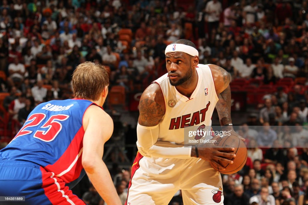 LeBron James #6 of the Miami Heat controls the ball against Kyle Singler #25 of the Detroit Pistons on March 22, 2013 at American Airlines Arena in Miami, Florida.