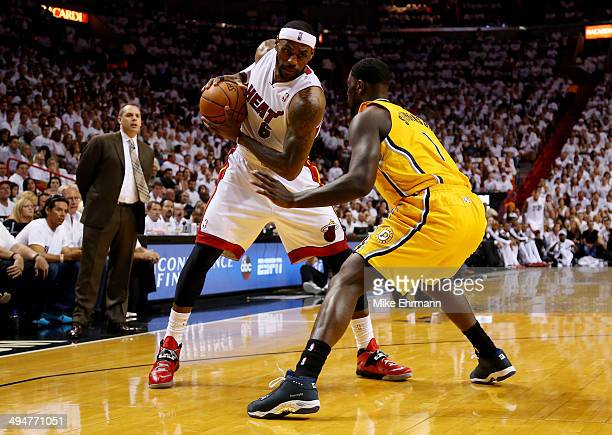 LeBron James of the Miami Heat controls the ball as Lance Stephenson of the Indiana Pacers defends during Game Six of the Eastern Conference Finals...