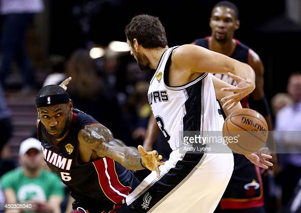 LeBron James of the Miami Heat defends against Marco Belinelli of the San Antonio Spurs during Game Two of the 2014 NBA Finals at the ATT Center on...