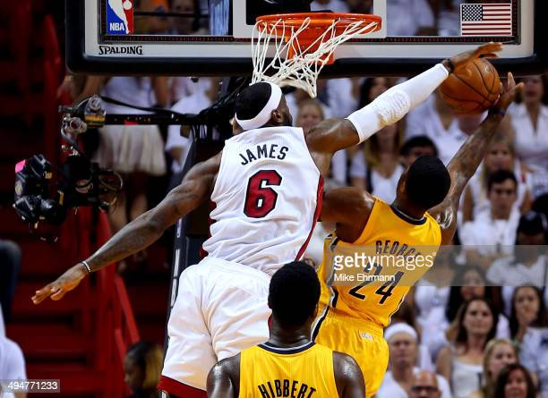 LeBron James of the Miami Heat defends against Paul George of the Indiana Pacers during Game Six of the Eastern Conference Finals of the 2014 NBA...