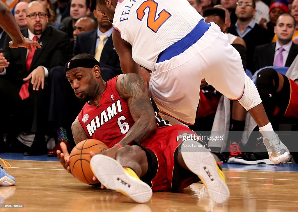 LeBron James #6 of the Miami Heat dives on a loose ball under Raymond Felton #2 of the New York Knicks at Madison Square Garden on March 3, 2013 in New York City.NOTE