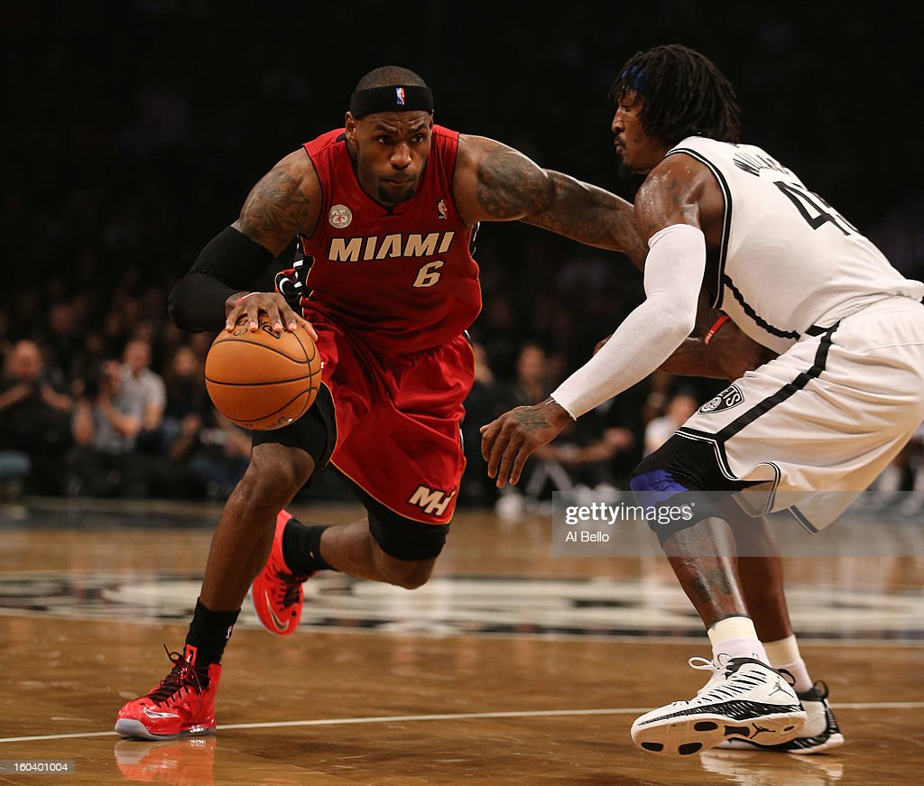LeBron James #6 of the Miami Heat dribbles against Gerald Wallace #45 of the Brooklyn Nets during their game at the Barclays Center on January 30, 2013 in the Brooklyn borough of New York City.