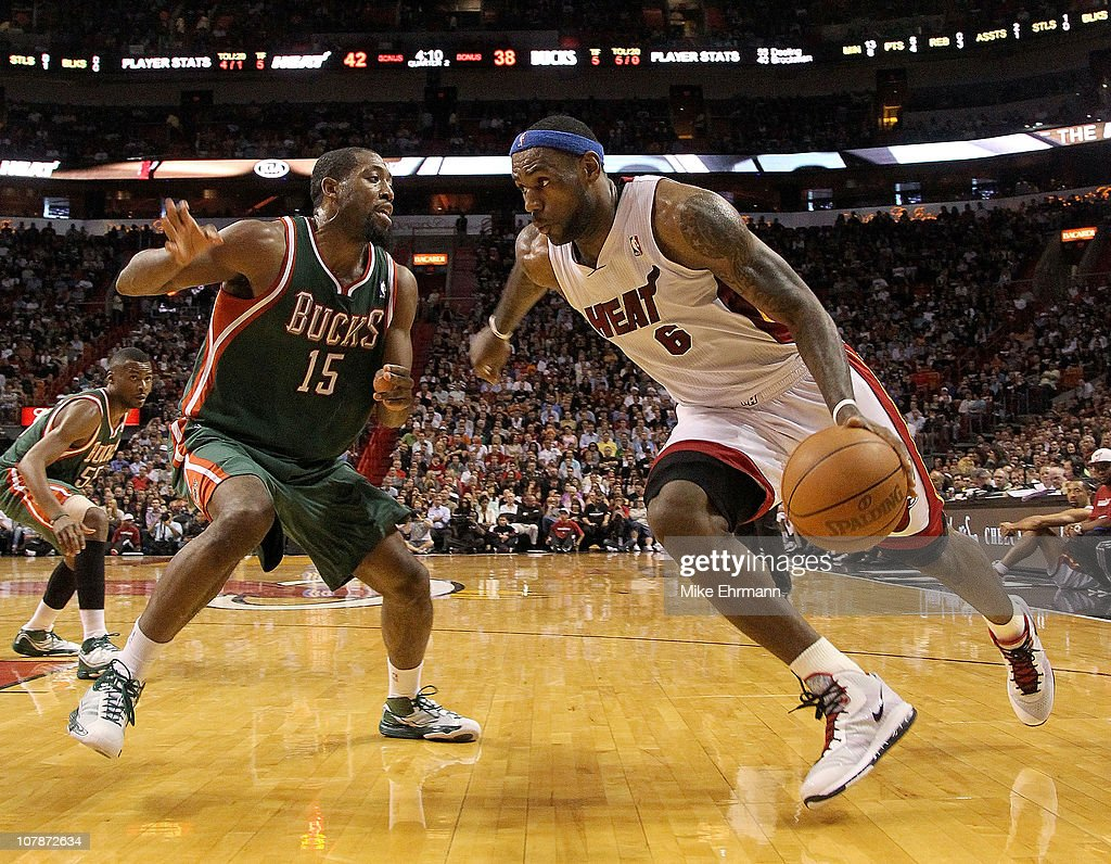 LeBron James of the Miami Heat dribbles around John Salmons of the Milwaukee Bucks during a game at American Airlines Arena on January 4 2011 in...